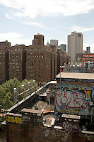 New York, NY 3 August 2008 - Graffiti and cell phone receptors on a Chinatown tenement rooftop with the Verizon Headquarters on the horizon.