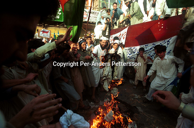 Demonstrators burning a doll of US President George Bush at a pro-Taleban demonstration on September 28, 2001 in the old town in Peshawar, Pakistan. A big demonstration was held after the Friday prayer supporting of Osama Bin Laden and the Taleban movement in Afghanistan..Photo: Per-Anders Pettersson/ iAfrika Photos...