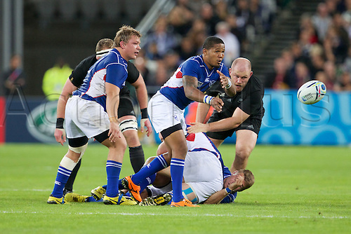 24.09.2015. Olympic Stadium, London, England. Rugby World Cup. New Zealand versus Namibia. Namibia scrum-half Eugene Jantjies clears the ball.