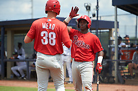 GCL Phillies East Wilfredo Flores (2) high fives Curtis Mead (38) during a Gulf Coast League game against the GCL Yankees East on July 31, 2019 at Yankees Minor League Complex in Tampa, Florida.  GCL Phillies East defeated the GCL Yankees East 4-3 in the second game of a doubleheader.  (Mike Janes/Four Seam Images)