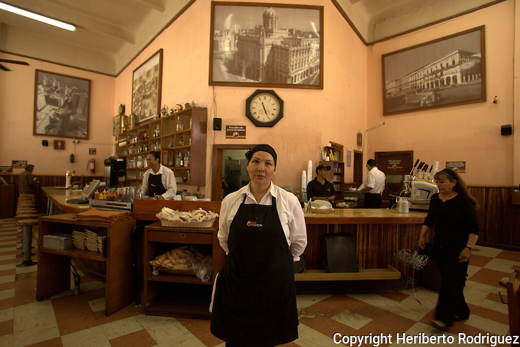 Mexican neighbors goes outside the Cafe La Habana, one of the most known coffee shops in Mexico City, August 11, 2011. Photo by Heriberto Rodriguez