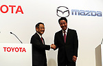 August 4, 2017, Tokyo, Japan - Japan's automobile giant Toyota Motor president Akio Toyoda (L) shakes hands with Mazda Motor president  Masamichi Kogai as they agreed business and capital allience at a Tokyo hotel on Friday, August 4, 2017. They announced to form a joint venture to produce vehicle in the United States.  (Photo by Yoshio Tsunoda/AFLO) LwX -ytd-