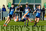 Ulster University player Michael McEvoy with a mid air possession despite the attention from Daniel O'Keefe, Conor Byrne and Conor Keane of  I T Tralee in the 1st round game of the Sigerson Cup Senior football in John Mitchells on Sunday.