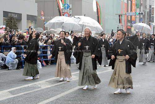 March 27, 2013, Tokyo, Japan - Nakamura Tokizo, center, walks with other Kabuki actors during a parade in the rain through the main street of Tokyo's Ginza shopping district on Wednesday, March 27, 2013, in celebration of the grand opening of new Kabuki theater. After three years of renovation, the majestic theater for Japan's centuries-old performing arts of Kabuki will open its doors to the public with a three-month series of most sought-after plays. (Photo by Kaku Kurita/AFLO)