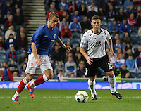 Dean Shiels watched by Chris Mitchell in the Rangers v Queen of the South Quarter Final match in the Ramsdens Cup played at Ibrox Stadium, Glasgow on 18.9.12.