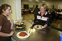 Mercedes Lockwood helps serve spaghetti as the Lions Club hosts the 14th annual spaghetti dinner to benefit the Dana Foundation of Dana Middle School, Sunset Cliffs Surfing Association Spinal Chord Injuries and the Guide Dogs of the Desert, Saturday, February 2, 2008.