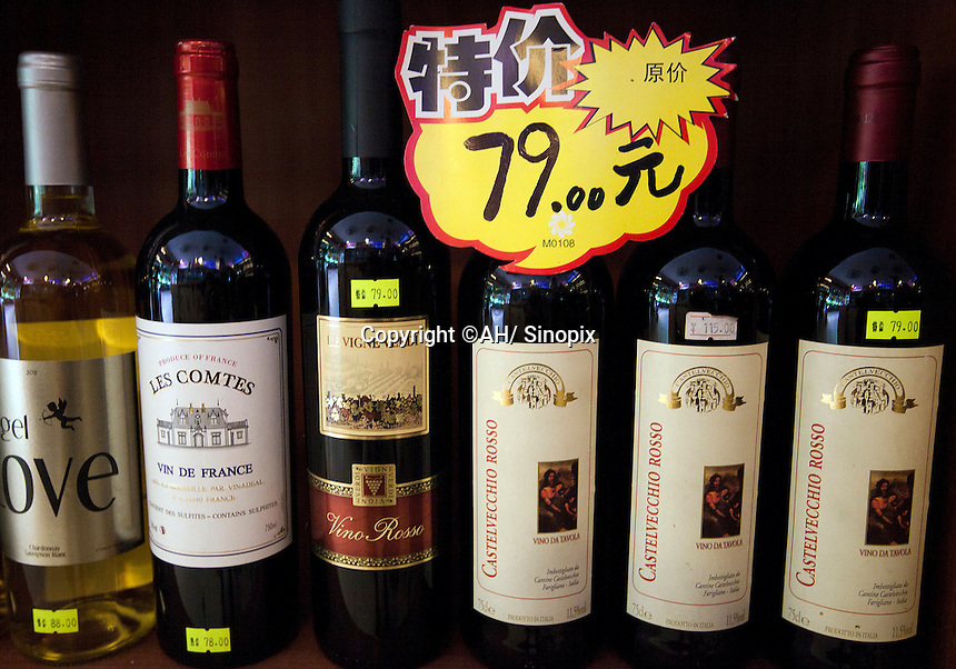 Bottles of wine are seen in a shop selling real and fake wine, Guangzhou, Guangdong Province, China, 18 July 2014.<br /> <br /> PHOTO BY SINOPIX