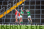 Aidan O'Mahony Rathmore Shaun Keane and Billy Maguire Legion compete for the kick out during the O'Donoghue cup final in Fitzgerald Stadium on Saturday