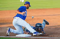 Malik Collymore (34)) of the Helena Brewers slides into third base as Jimy Perez (12) of the Ogden Raptors tries to handle the throw in Pioneer League action at Lindquist Field on August 17, 2015 in Ogden, Utah. Ogden defeated Helena 7-2.  (Stephen Smith/Four Seam Images)