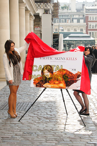 Lauren Goodger.PETA Sexy anti-exotic photocall, Covent Garden, London, England..April 3rd, 2012.full length white jacket blazer print dress beige lace shoes poster board red cloth .CAP/CJ.©Chris Joseph/Capital Pictures.