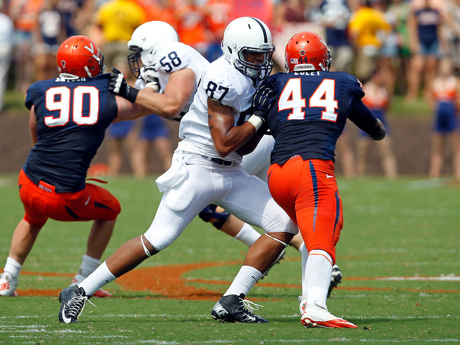 Penn State tight end Kyle Carter (87) blocks Virginia fullback Sammy MacFarlane (44) during an NCAA college football game in Charlottesville, Va. Virginia defeated Penn State 17-16.