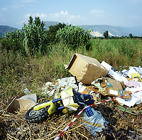 Piles of illegally disposed trash lay abandoned next to a bridge and farm land near Marigliano, Italy. Urban waste can be found throughout the provinces of Naples and Caserta. Surrounding farms have seen a drop in production quality of produce. While organized crime can blamed for much of the illegal toxic waste dumping from Northern Italian companies, local citizens have, as well, become accustomed to illegal dumping of waste leading to further contamination of the countryside. ..PHOTOS/ MATT NAGER