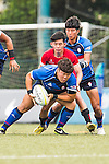 Taeho Bak of South Korea battles for the ball during the match between South Korea and Singapore of the Asia Rugby U20 Sevens Series 2016 on 12 August 2016 at the King's Park, in Hong Kong, China. Photo by Marcio Machado / Power Sport Images