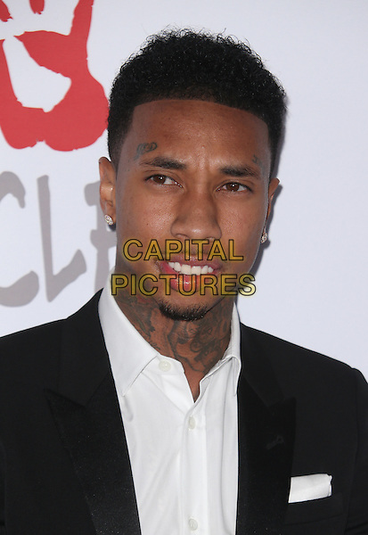 Santa Monica, CA - December 10 Tyga Attending Rihanna and The Clara Lionel Foundation Host 2nd Annual Diamond Ball At The Barker Hanger On December 10, 2015. <br /> CAP/MPI/FS<br /> &copy;FS/MPI/Capital Pictures