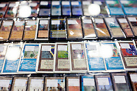 Thousands of unique Magic: The Gathering Cards have been printed since the game's premier in 1993. Vendors set up booths to buy, sell, and trade cards at all levels. The most expensive present over the weekend was a Black Lotus for $6,000. In 2013 a mint Black Lotus sold for $27,302 on eBay.<br /> <br /> <br /> Danny Ghitis for Bloomberg Businessweek