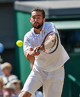 London, England, 6 th July, 2016, Tennis, Wimbledon, Quarter final men, Marin Cilic (CRO) in action during his match against Roger Federer (SUI)<br /> Photo: Henk Koster/tennisimages.com