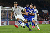 Artem Kravets of Dynamo Kyiv holds the ball up under pressure from Cesar Azpilicueta of Chelsea during the UEFA Champions League Group match between Chelsea and Dynamo Kyiv at Stamford Bridge, London, England on 4 November 2015. Photo by David Horn.