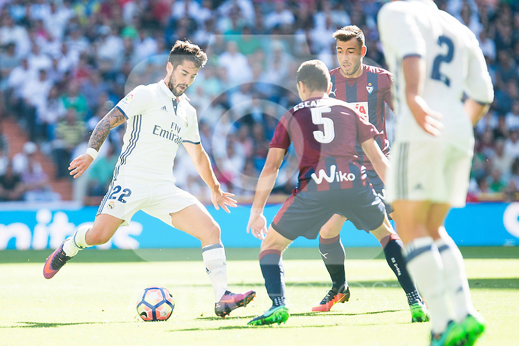 "Real Madrid's player Francisco Roman ""Isco"" and Eibar FC's player Gonzalo Escalante during a match of La Liga Santander at Santiago Bernabeu Stadium in Madrid. October 02, Spain. 2016. (ALTERPHOTOS/BorjaB.Hojas)"