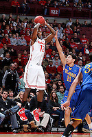 Ohio State Buckeyes forward Sam Thompson (12) gets a shot off against Delaware Blue Hens forward Devonne Pinkard (11) during the second half of the NCAA men's basketball game at Value City Arena on Wednesday, December 18, 2013. Ohio State beat Delaware, 76-64. (Columbus Dispatch photo by Jonathan Quilter)