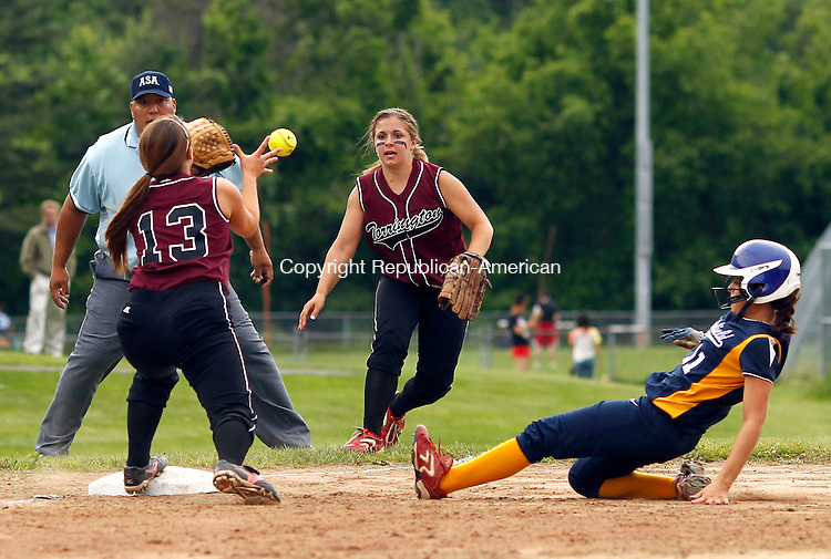Torrington, CT-01 June 2012-060112CM03-  Torrington's Mollie Bartles (center) flips the ball to third baseman, Baylee Vinisko (13) for the out as Brookfield's Jessica Angelo slides in during the Class L softball quarterfinals Friday afternoon in Torrington.  The Red Raiders lost 5-1 and were eliminated from the tournament. Christopher Massa Republican-American