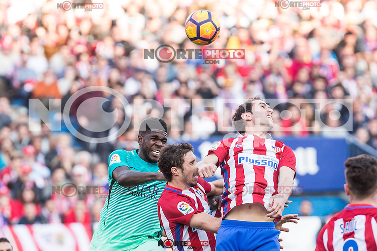 Samuel Umiti of Futbol Club Barcelona competes for the ball with Diego Godin and Vrsaljko of Atletico de Madrid  during the match of Spanish La Liga between Atletico de Madrid and Futbol Club Barcelona at Vicente Calderon Stadium in Madrid, Spain. February 26, 2017. (ALTERPHOTOS) /NortEPhoto.com