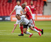 7th July 2020; City Ground, Nottinghamshire, Midlands, England; English Championship Football, Nottingham Forest versus Fulham; Bobby Reid of Fulham is pushed down and fouled by Samba Sow of Notts Forest