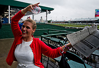 LOUISVILLE, KENTUCKY - MAY 04: A fan dances after finishing her Oaks Lily during Thurby at Churchill Downs on May 4, 2017 in Louisville, Kentucky. (Photo by Scott Serio/Eclipse Sportswire/Getty Images)