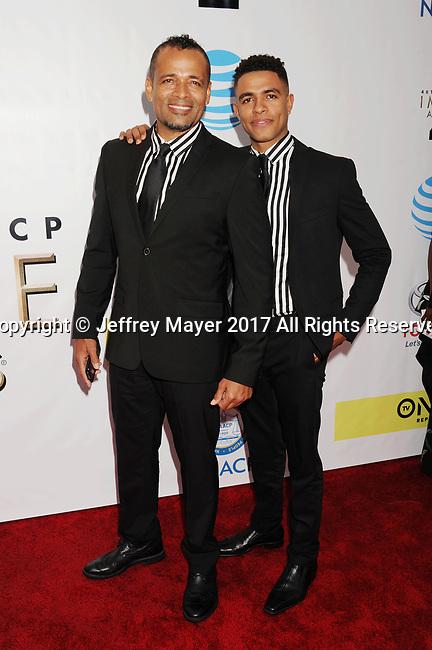 PASADENA, CA - FEBRUARY 11: Actor Mario Van Peebles (L) and Mandela Van Peebles arrive at the 48th NAACP Image Awards at Pasadena Civic Auditorium on February 11, 2017 in Pasadena, California.