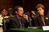 Michael J. Fox testifies during a hearing of the United States Senate Appropriations Subcommittee on Labor, HHS, and Education on the benefits of stem cell research in Washington, D.C. on September 14, 2000.  At right is actress Mary Tyler Moore..Credit: Ron Sachs / CNP