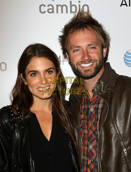 "Nikki Reed & Paul McDonald.""Aim High"" Los Angeles Premiere held at Trousdale, West Hollywood, California, USA..October 18th, 2011.half length black jeans denim top jacket bag purse boots leather brown couple married husband wife beard facial hair headshot portrait .CAP/ADM/KB.©Kevan Brooks/AdMedia/Capital Pictures."