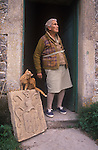 Jane Parfitt, with coat of arms from Spargrove manor House. Parfitt Sisters, Spargrove Manor, Batcombe, Somerset. Taken for the Sunday Times Magazine 1988. Used December 1988.