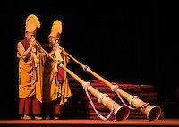 TIBETAN MONKS BLOW HORNS during TIBET NIGHT at a DALAI LAMA teaching in October 2007 sponsored by KUMBUM CHAMTSE LING & the TIBETAN CULTURAL CENTER - BLOOMINGTON, INDIANA