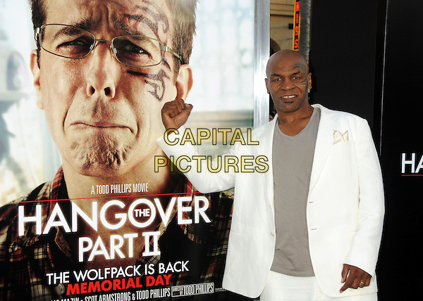 "MIKE TYSON .""The Hangover Part II"" Los Angeles Premiere held at Grauman's Chinese Theatre, Hollywood, California, USA, 19th May 2011..2  half length hand fist gesture suit jacket white tattoo on face grey gray t-shirt  poster .CAP/ADM/BP.©Byron Purvis/AdMedia/Capital Pictures."