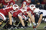 Wisconsin Badgers offensive linemen line up during an NCAA Big Ten Conference college football game against the Penn State Nittany Lions on November 26, 2011 in Madison, Wisconsin. The Badgers won 45-7. (Photo by David Stluka)