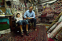 Iraq 2011  In the souk of Erbil, the shop of a rug salesman with a young boy <br />