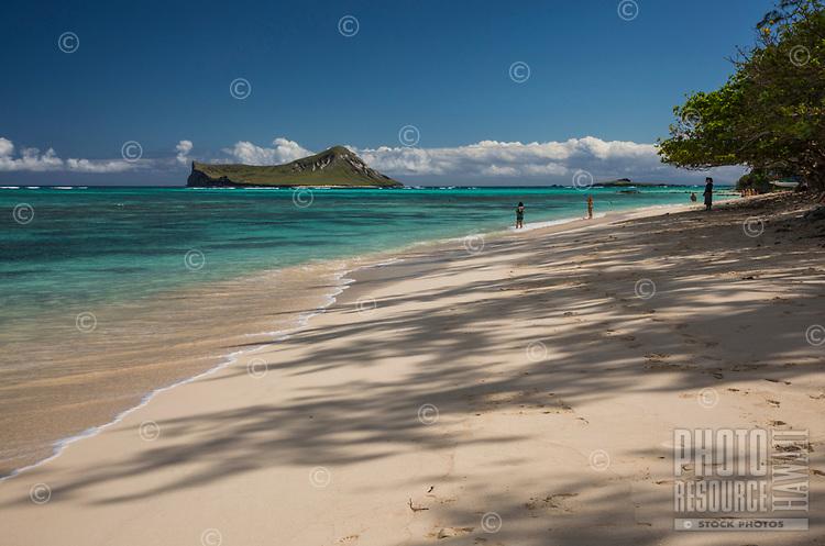 Beachgoers enjoy the view of Manana and Kaohikaipu Islands from Waimanalo Beach, Windward O'ahu.