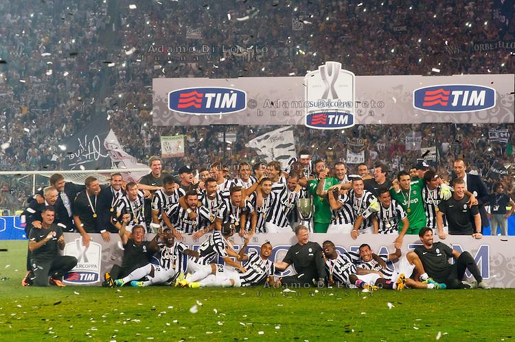 Juventus beat Lazio 4-0 in the Italian Supercoppa final match in Rome, Italy, on August 18, 2013. In the photo: the Juventus team with the supercup. Photo: Adamo Di Loreto/BuenaVista*photo