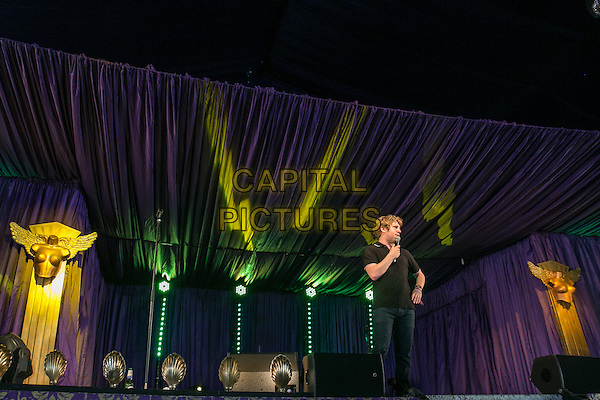 18th July 2014: English Comedian &amp; panel show regular Josh Widdicombe plays the Comedy Arena on the first day of the 9th edition of the Latitude Festival, Henham Park, Suffolk. <br /> CAP/PP/STU<br /> &copy;Stuart Hogben/PP/Capital Pictures