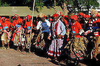 ZAMBIA Barotseland , Zambezi floodplain , Kuomboka ceremony in Limulunga, the Lozi king Lubosi Imwiko II. also called Litunga, change his residence after raining time with the royal bark Nalikwanda  to his palace in Limulunga where his people welcome him with dances / SAMBIA Barotseland , Flutebene des Zambezi Fluss , Kuomboka Fest in Limulunga, Feiern zu Ehren des Lozi Koenig, Litunga , Taenze nach Ankunft in seiner Residenz in Limulunga