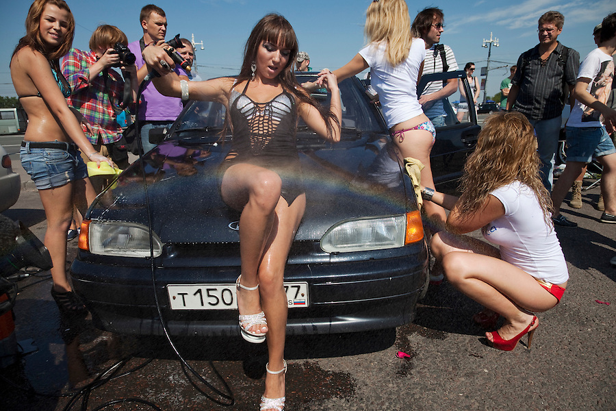 "Moscow Russia, 21/07/2011..Pro-Putin activists calling themselves ""We Love Putin"" wash Russian-made cars in support of the domestic car industry. The young women in bikinis and high heel shoes say they can wash every Russian car for free to show their support for the Prime Minister, who is also known as a fan of Russian cars."