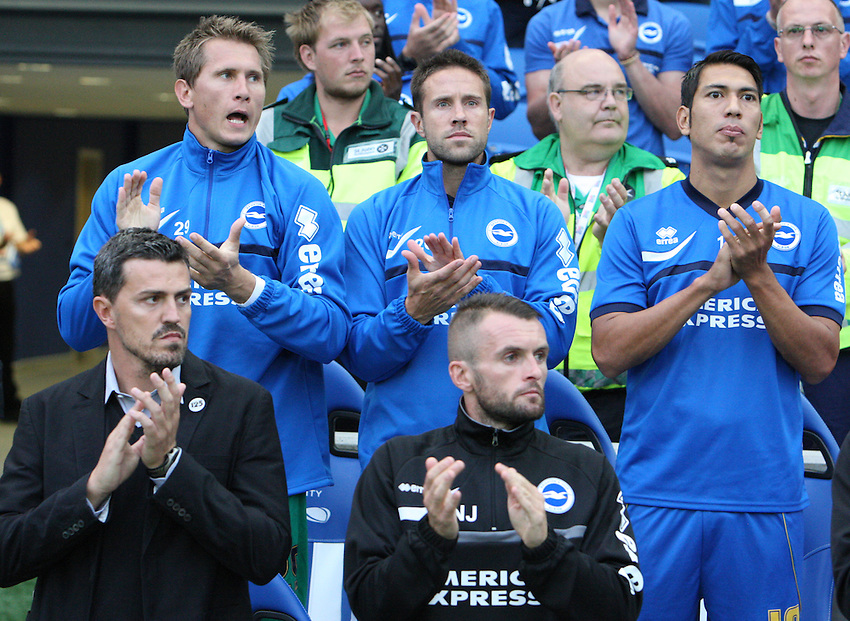 Back Row: L-R Brighton and Hove Albion's Tomasz Kuszczak, Matthew Upson and Leonardo Ulloa<br /> Front Row : L-R Brighton and Hove Albion's Manager Oscar Garcia and Assiatant Head Coach Nathan Jones  before kick off<br /> (Photo by Kieran Galvin/CameraSport<br /> <br /> Football - Capital One Cup First Round - Brighton and Hove Albion v Newport County - Tuesday 6th August 2013 - American Express Community Stadium - Brighton<br />  <br /> &copy; CameraSport - 43 Linden Ave. Countesthorpe. Leicester. England. LE8 5PG - Tel: +44 (0) 116 277 4147 - admin@camerasport.com - www.camerasport.com