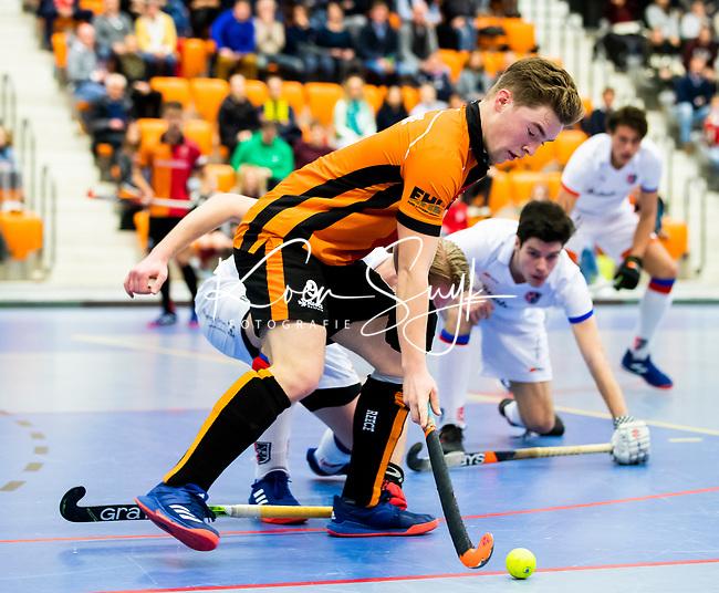 ROTTERDAM  - NK Zaalhockey,   halve finale heren Oranje Rood-SCHC (SCHC wint en plaatst zich voor de finale) . Jim van de Venne (Oranje-Rood)    COPYRIGHT KOEN SUYK
