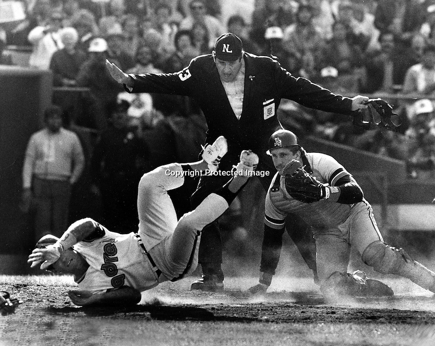ALL STAR GAME: Umpire Lee Weyer gives the safe sign as Steve Garvey of the San Diego Padre's slides past catcher Lance Parrish of the Detroit Tigers.