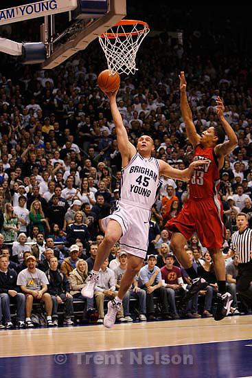 Provo - - BYU vs. UNLV college basketball. , Wednesday, January 21, 2009.; 01.21.2009.  BYU guard Jonathan Tavernari (45), of Brazil, UNLV guard Tre'Von Willis (33)