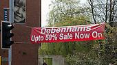 Banner advertising Debenham's 50% off sale, Guildford, Surrey.