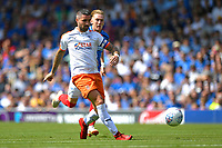 Alan Sheehan of Luton Town plays a pass under pressure from Brandon Haunstrup of Portsmouth during Portsmouth vs Luton Town, Sky Bet EFL League 1 Football at Fratton Park on 4th August 2018