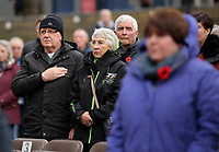 Pictured: People observe the two minute silence. Saturday 11 November 2017<br /> Re: Armistice Day, two minutes were observed to mark remembrance at Castle Square in Swansea, Wales, UK.