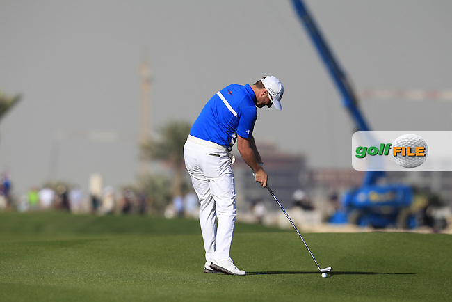 Marc WARREN (SCO) plays his 2nd shot on the 10th hole during Saturday's Final Round of the 2015 Commercial Bank Qatar Masters held at Doha Golf Club, Doha, Qatar.: Picture Eoin Clarke, www.golffile.ie: 1/24/2015