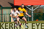 Eoin Lawlor Rathmore turns Jamie barry Listowel Emmets during their Division 2 clash in Rathmore on Sunday