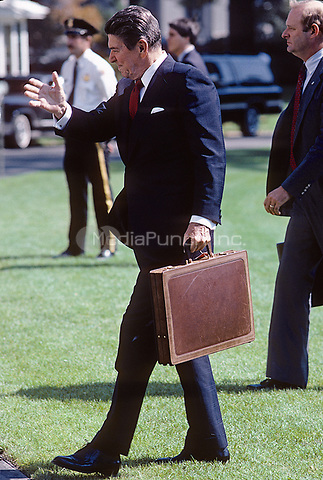 Washington DC., USA, October, 1984<br /> President Ronald Reagan walks back to the White House after arriving on the South Lawn in Marine One. Credit: Mark Reinstein/MediaPunch